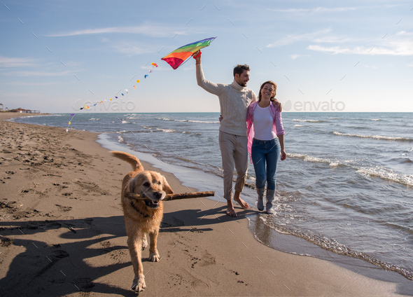 happy couple enjoying time together at beach - Stock Photo - Images