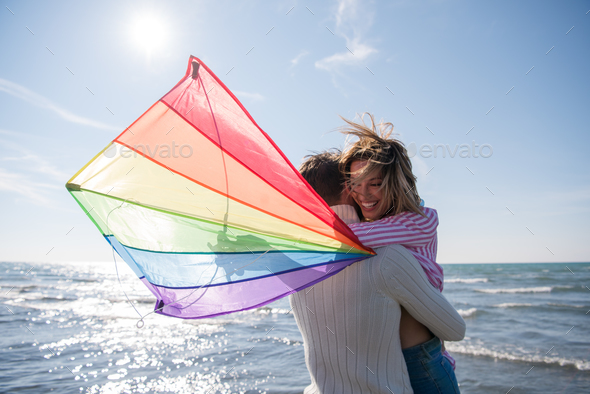 Couple enjoying time together at beach - Stock Photo - Images