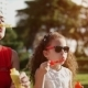 Happy Mom and Child Blowing Soap Bubbles in Park - VideoHive Item for Sale