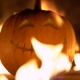 Smiling Happy Carved Halloween Pumpkin Against of Fiery Explosion Background. Glowing Face Trick or - VideoHive Item for Sale