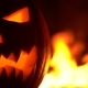 Orange Mad Pumpkin As Head of Jack-o-lantern with Carved Eyes and Wicked Smirk in Hot Burning Hell - VideoHive Item for Sale
