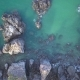 Aerial View of the Blue Wild Laguna Beach Coastline Bay with the Rocks and Cliffs - VideoHive Item for Sale