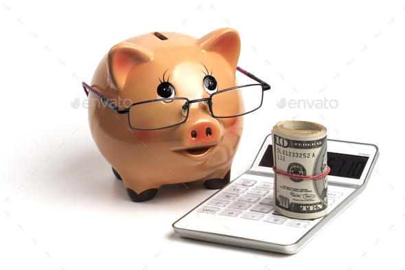 Piggy Bank and White Calculator - Stock Photo - Images