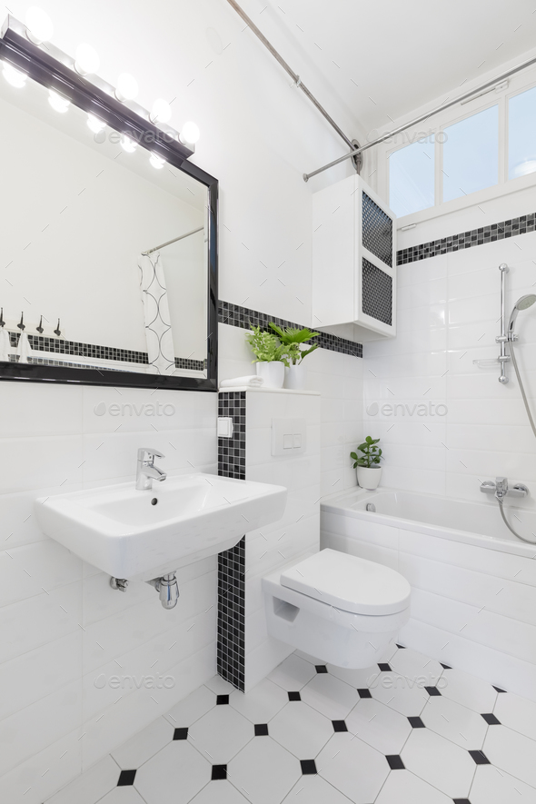 Mirror above washbasin in black and white bathroom interior with - Stock Photo - Images