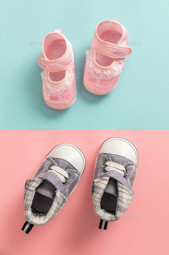 aaca063f86169 Baby boy and girl shoes on pastel colors background