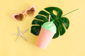Fancy glass with heart shape sunglasses on pastel colors background, Summer concept - PhotoDune Item for Sale