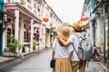 Young couple traveler walking at Phuket old town in Thailand - PhotoDune Item for Sale
