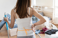 Tired young woman in the bedroom with cleaning products and equipment, Housework concept - PhotoDune Item for Sale