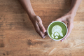 Green tea matcha latte in a cup on wooden background - PhotoDune Item for Sale
