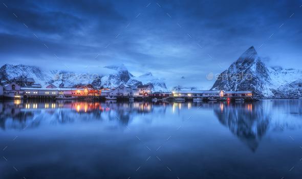 Beautiful fishing village with boats at night, Lofoten islands - Stock Photo - Images