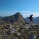A Girl with a Backpack Travels in the Mountains - VideoHive Item for Sale