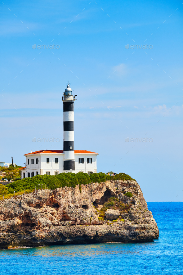 Portocolom Lighthouse on a cliff. - Stock Photo - Images
