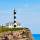 Portocolom Lighthouse on a cliff. - PhotoDune Item for Sale