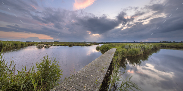 Wooden footbridge over river - Stock Photo - Images