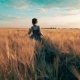 Girl Runs Across the Field with Wheat - VideoHive Item for Sale