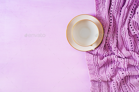 Empty white coffee cup  on violet background, close up photo knitted sweater with mug - Stock Photo - Images