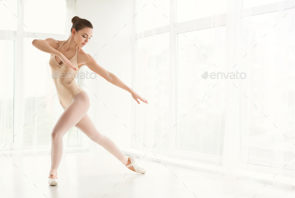 Ballerina in point shoes and dancing in studio - Stock Photo - Images