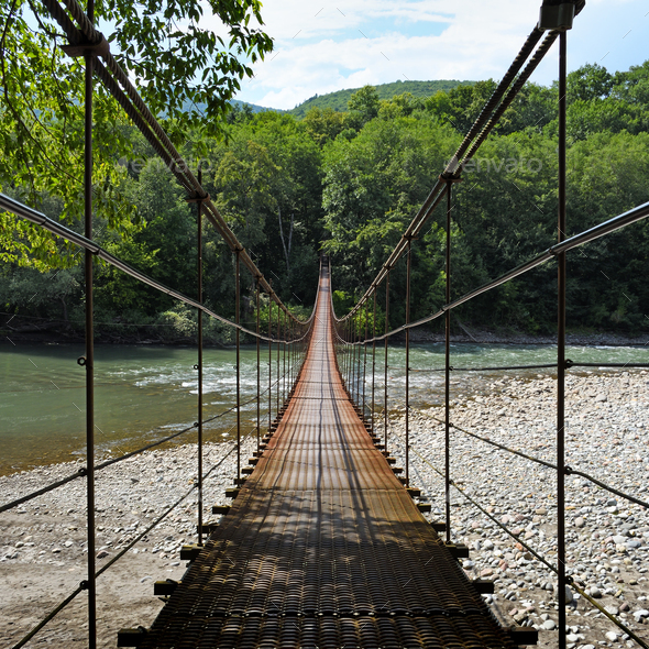 Suspension bridge through river Belaya in Republic of Adygea, Russia - Stock Photo - Images
