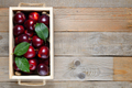 Plums in box on wooden table - PhotoDune Item for Sale