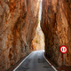 Narrow road cut through a mountain. - PhotoDune Item for Sale