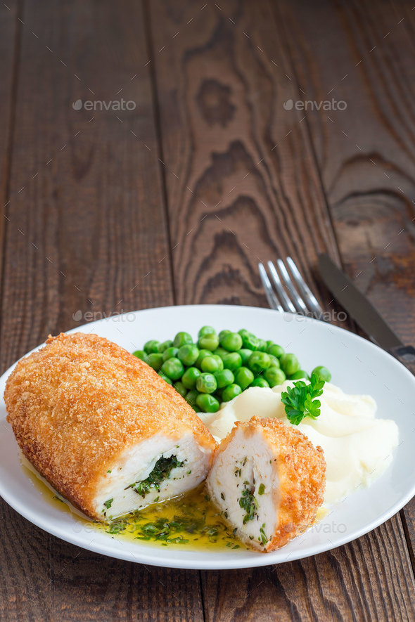 Chicken Kiev, ukrainian cuisine. Cutted chicken cutlet in bread - Stock Photo - Images