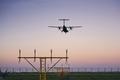 Airplane landing at dusk - PhotoDune Item for Sale