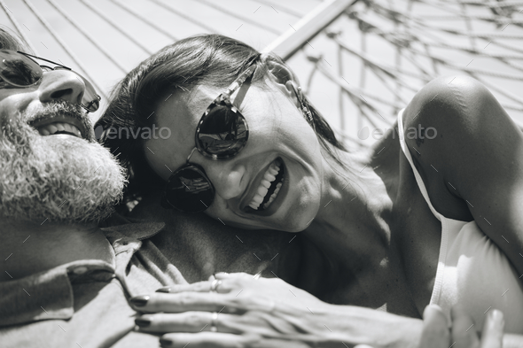 Couple resting together in a hammock - Stock Photo - Images