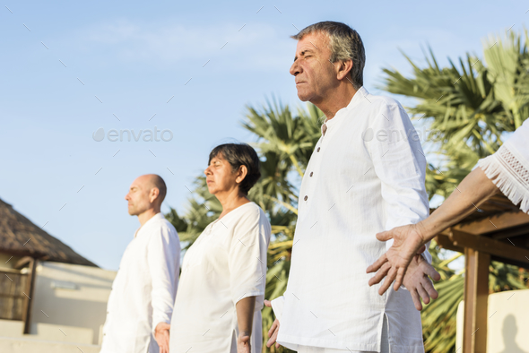 Group of seniors practicing yoga in the morning - Stock Photo - Images