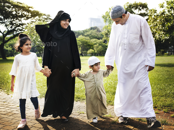 Muslim family having a good time outdoors - Stock Photo - Images