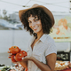 Woman buying tomatoes at a farmers market - PhotoDune Item for Sale