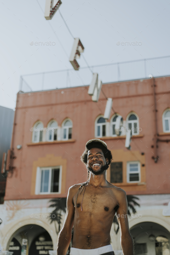 Shirtless man at Venice Beach - Stock Photo - Images