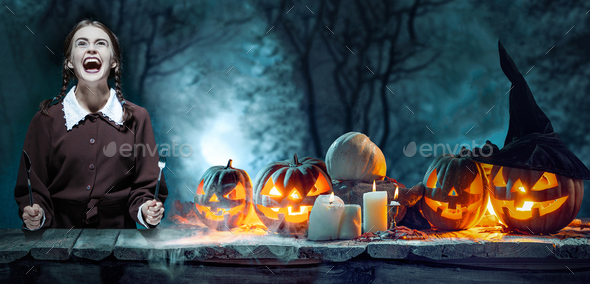 Bloody Halloween theme: crazy girl with a knife - Stock Photo - Images