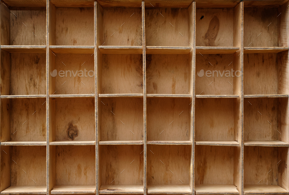 Empty wooden cabinet with cells - Stock Photo - Images