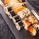 Plate with variety of sushi on a dark stone - PhotoDune Item for Sale