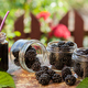 Fruit jam with spoon and berries in glass on a table - PhotoDune Item for Sale
