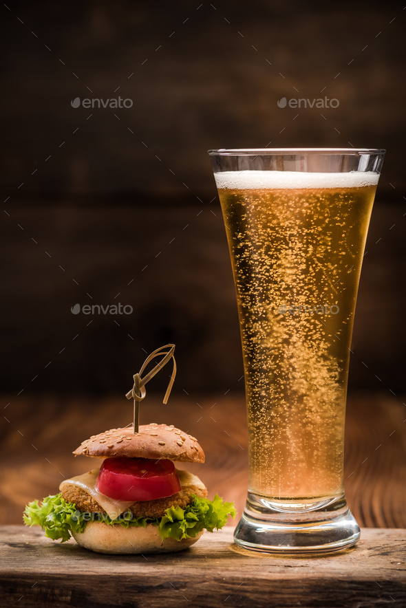 Chicken burger with glass of beer - Stock Photo - Images