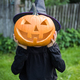 Funny girl with halloween pumpki in garden - PhotoDune Item for Sale