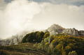 Misty autumn morning landscape. Mountain peak in fog and trees w - PhotoDune Item for Sale