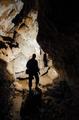 Man in dark cave - PhotoDune Item for Sale