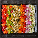 Sliced vegetables on a baking tray prepared for baking. - PhotoDune Item for Sale