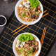 Vegan noodle soup with tofu cheese, shiitake mushrooms and lettuce in white bowl.  - PhotoDune Item for Sale