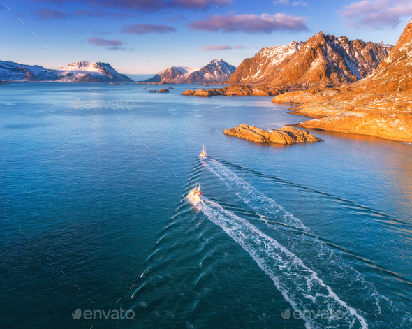 Aerial view of fishing boats, rocks in the blue sea - Stock Photo - Images