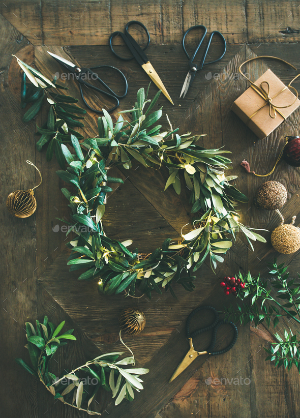 Flat-lay of Christmas decoration toys and wreath over wooden background - Stock Photo - Images