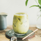 Iced matcha latte drink, white wall at background, vertical composition - PhotoDune Item for Sale