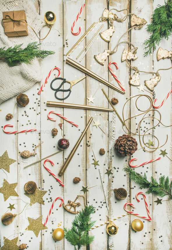 Flat-lay pattern of holiday decoration objects, toys, candles, winter sweater - Stock Photo - Images