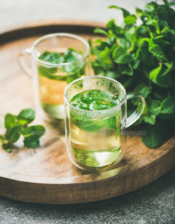 Hot herbal mint tea in glass mugs with leaves, close-up - Stock Photo - Images