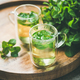 Hot herbal mint tea in glass mugs with leaves, close-up - PhotoDune Item for Sale