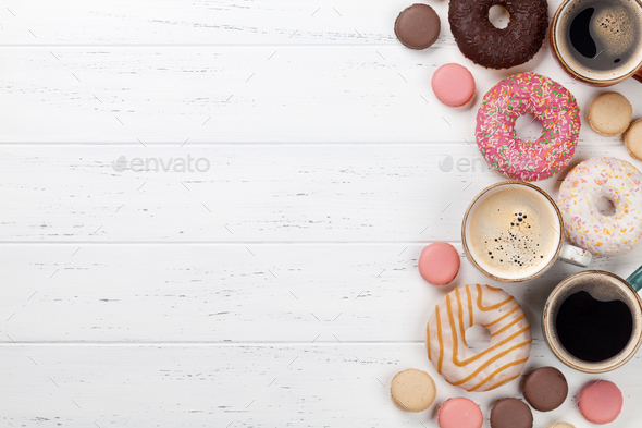 Coffee cups, donuts and macaroons - Stock Photo - Images