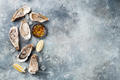 Fresh oysters on stone table - PhotoDune Item for Sale