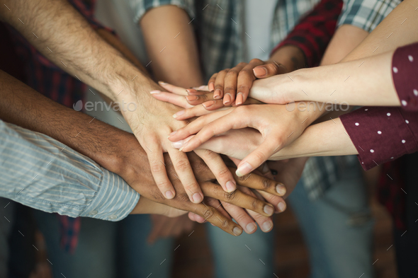 Group of friends holding hands together - Stock Photo - Images